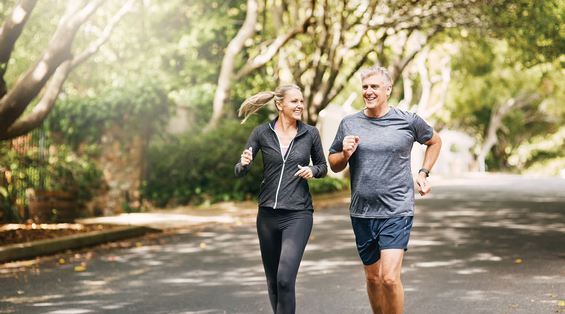 A middle-aged couple running together to keep fit