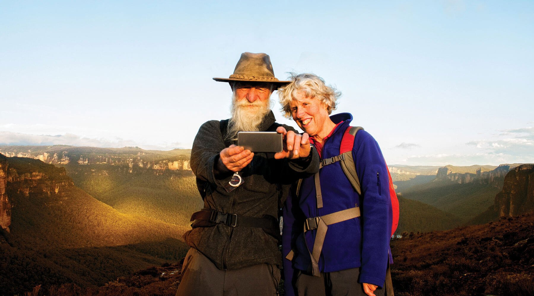 A older couple taking photo of scenic country for 360 Health + Community's country location headers