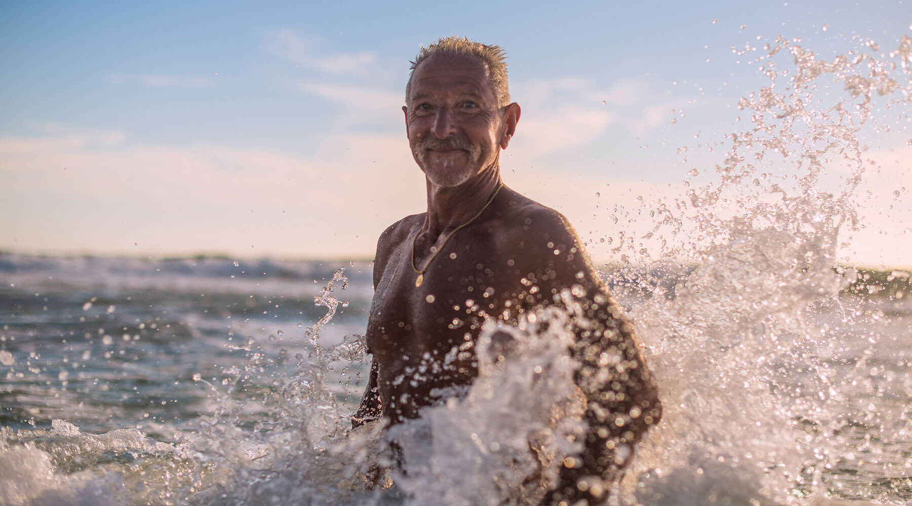 A grandfather in the ocean for 360 Health + Community's resource header