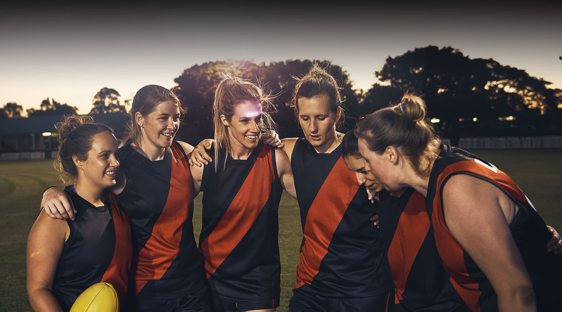 A group of middle-aged woman footballers with dark overlay for 360H+C headspace banner